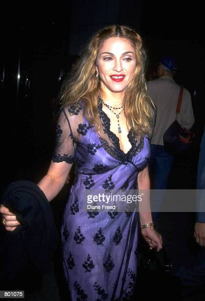 American singer and actress Madonna wearing lacy purple dress in New York City 1999