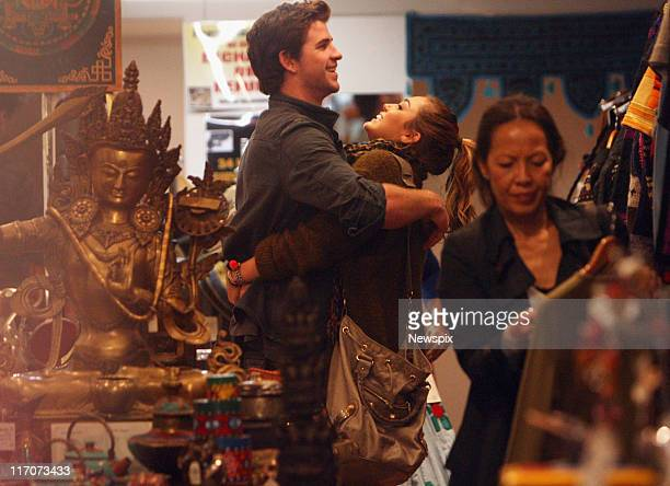 American singer and actress Miley Cyrus with her Australian actor boyfriend Liam Hemsworth shopping on Oxford Street Paddington in Sydney ahead of...