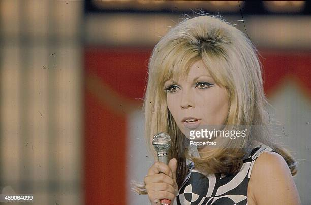 1968 American singer and actress Nancy Sinatra performs on stage at the Palladium Show in London in 1968