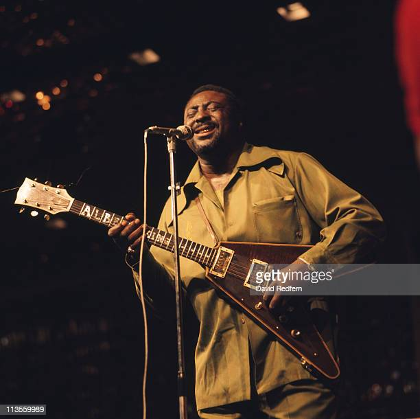 Albert King US blues guitarist and singer playing the guitar and singing into a microphone during a live concert performance at the New Orleans Jazz...