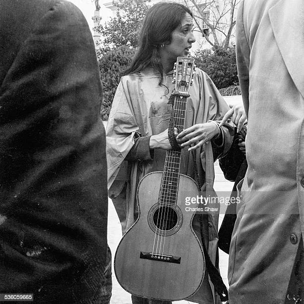 American singer and Civil Rights activist Joan Baez stands with an unidentified person at the end of the Selma to Montgomery March Montgomery Alabama...