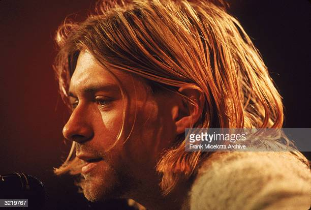 American singer and guitarist Kurt Cobain performs with his group Nirvana at a taping of the television program 'MTV Unplugged' New York New York...