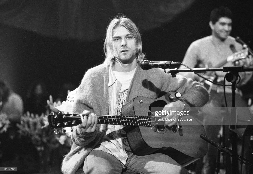 American singer and guitarist Kurt Cobain (1967 - 1994), performs with his group Nirvana at a taping of the television program 'MTV Unplugged,' New York, New York, Novemeber 18, 1993. Guitarist Pat Smear is visible at rear right.
