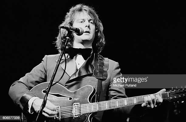 American singer and guitarist Roger McGuinn performing on stage USA 10th March 1977