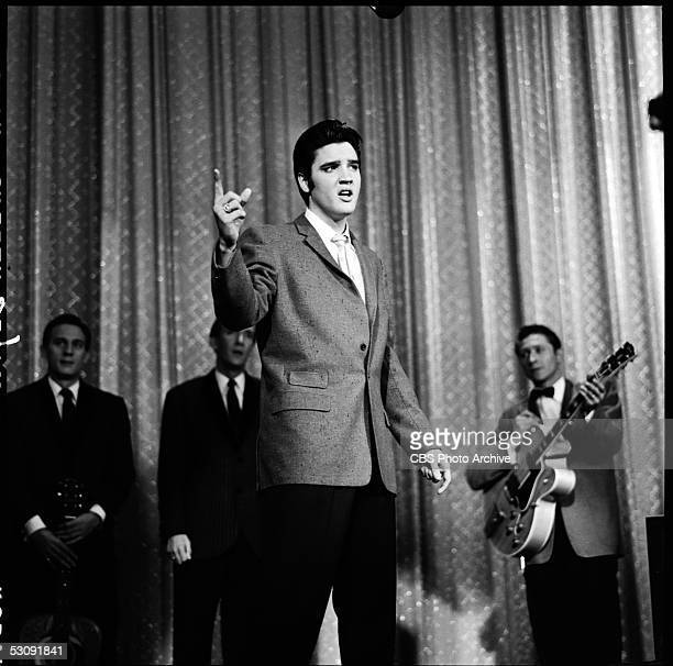 American singer and musician Elvis Presley performs with his band onstage during his second appearance on 'The Ed Sullivan Show' New York New York...