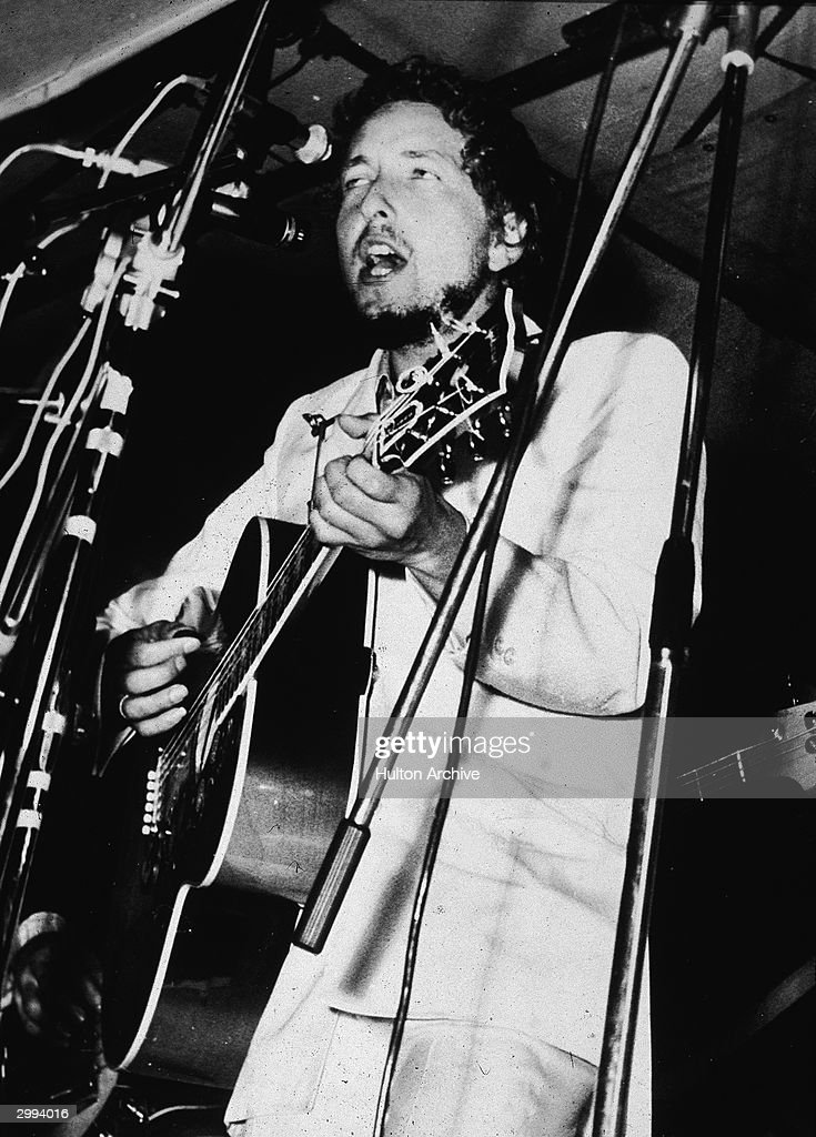 American singer and songwriter Bob Dylan plays acoustic guitar and sings on stage during his performance at the Isle Of Wight rock festival, Woodside Bay, August 31, 1969.