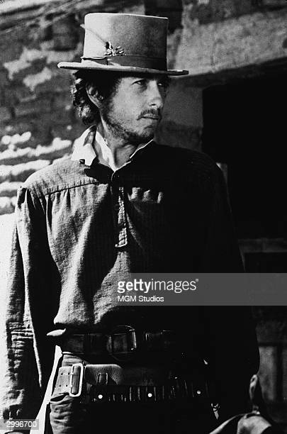 American singer and songwriter Bob Dylan wears a stovepipe hat in a still from the film western 'Pat Garrett Billy The Kid' directed by Sam Peckinpah...