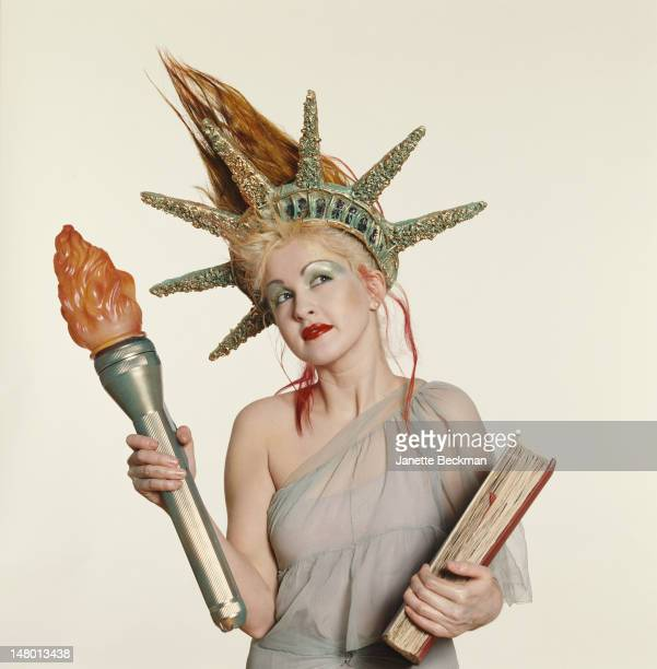 American singer and songwriter Cyndi Lauper dressed as the Statue of Liberty New York City 1988