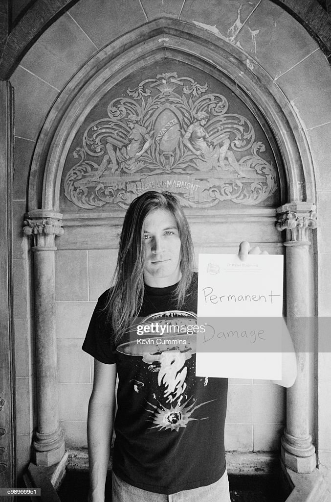 American singer and songwriter Evan Dando of The Lemonheads poses with the words 'Permanent Damage' written on hotel notepaper at the Chateau Marmont...