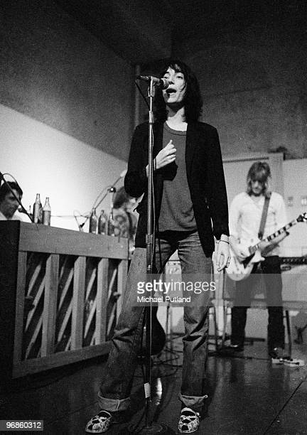 American singer and songwriter Patti Smith performing at the Ocean Club New York 21st July 1976 Left to right John Cale Smith and Mick Ronson