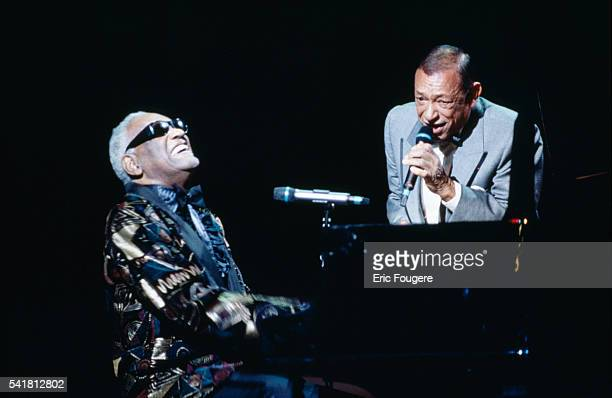 American singer and songwriter Ray Charles and French singer and songwriter Henri Salvador sing a duet at the 11th 'Victoires de la Musique' award...