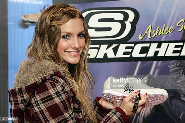 American singer Ashlee Simpson poses for photographers to celebrate the launch of her Skechers Campaign at Skechers Oxford Street store on October 25...