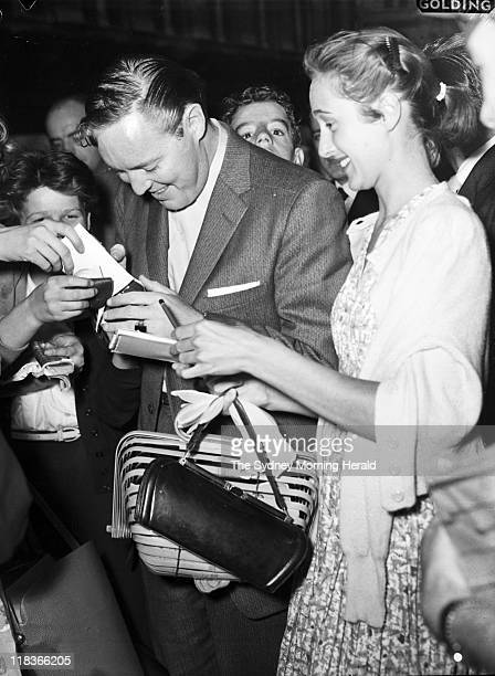 American singer Bill Haley is rushed by autograph hunters at the State Ballroom Sydney 7 January 1957