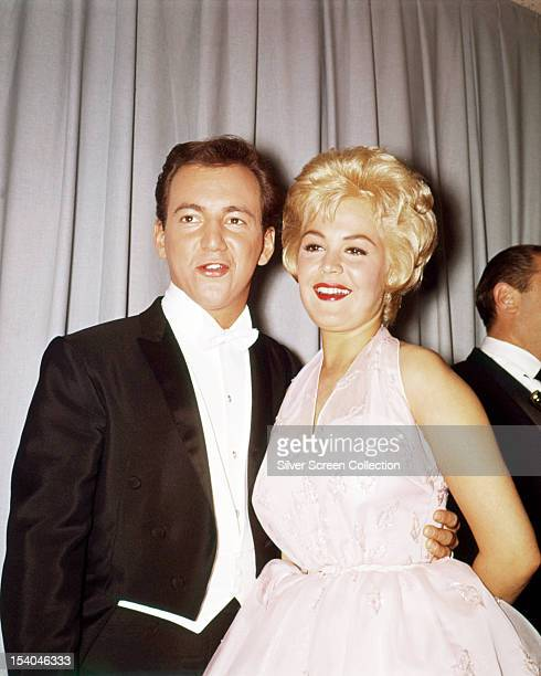 American singer Bobby Darin and his wife actress Sandra Dee at the 33rd Academy Awards Santa Monica California where they presented the music awards...