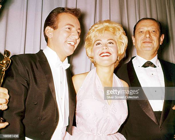 American singer Bobby Darin and his wife actress Sandra Dee with composer Harry Sukman at the 33rd Academy Awards Santa Monica California 17th April...