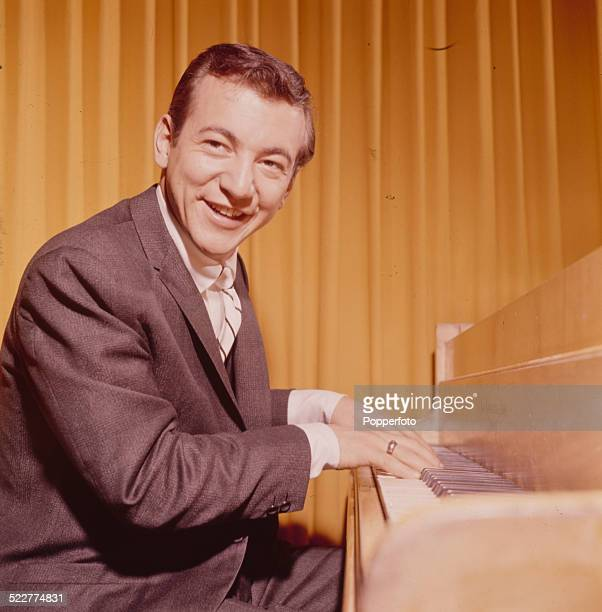 American singer Bobby Darin pictured playing a piano in London in 1963