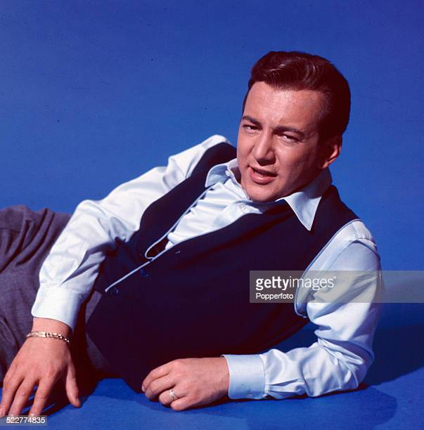 American singer Bobby Darin posed wearing a blue satin shirt and waistcoat in 1963
