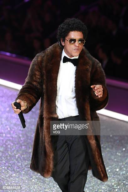 American singer Bruno Mars performs on the runway during 2016 Victoria's Secret Fashion Show on November 30 2016 in Paris France