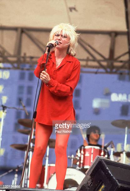 American singer Debbie Harry of the band Blondie performs on stage at Comiskey Park Chicago Illinois August 18 1979 Drummer Clem Burke is visible in...