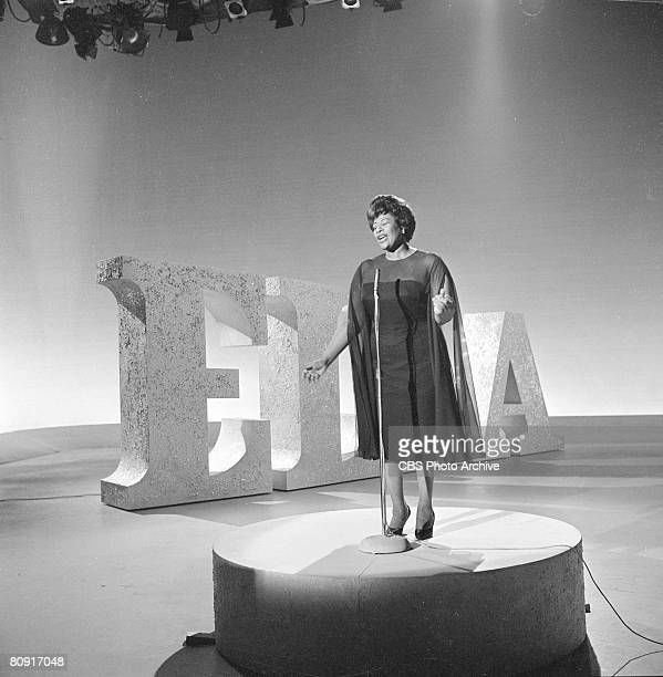 American singer Ella Fitzgerald performs next to a set of giant letters that spell her first name on an episode of 'The Ed Sullivan Show' New York...