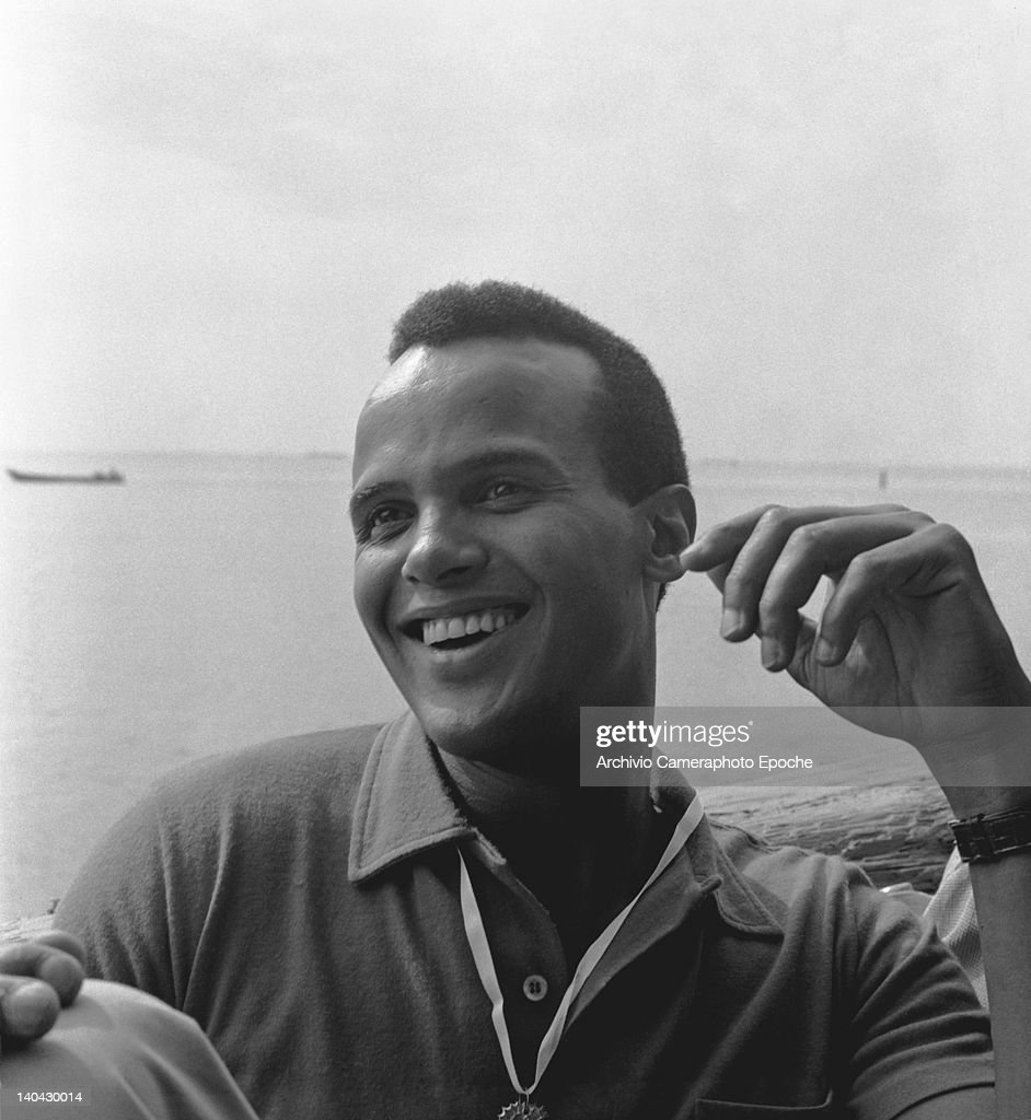 American singer <a gi-track='captionPersonalityLinkClicked' href=/galleries/search?phrase=Harry+Belafonte&family=editorial&specificpeople=204214 ng-click='$event.stopPropagation()'>Harry Belafonte</a> portrayed while smiling, Venice, 1958.
