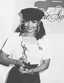 The singer songwriter Janet Jackson collecting an award holding a small statue 1972