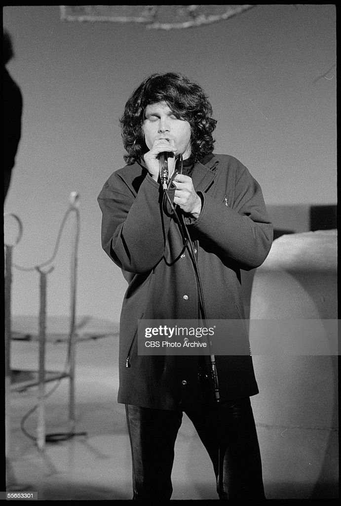 American singer Jim Morrison (1943 - 1971), leader of the rock band The Doors, closes his eyes as he performs on 'The Smothers Brothers Comedy Hour,' California, January 6, 1969.