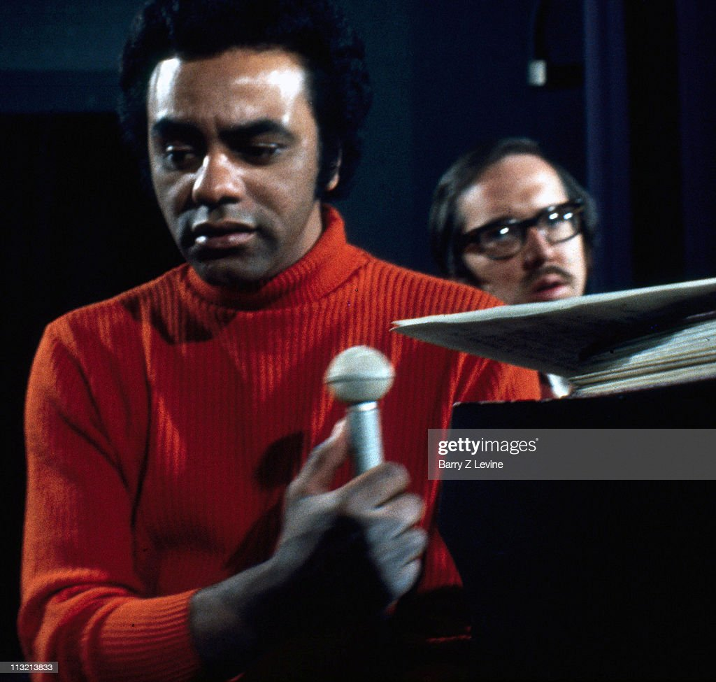 American singer Johhny Mathis and his conductor arranger and pianist Roy Rogosin rehearse for an upcoming New Year's Eve performance at the Hilton...
