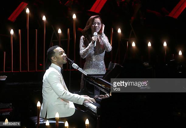 American singer John Legend and singer Jane Zhang perform onstage during Jane Zhang's concert 'Jane Zhang and her friends' on October 11 2015 in...