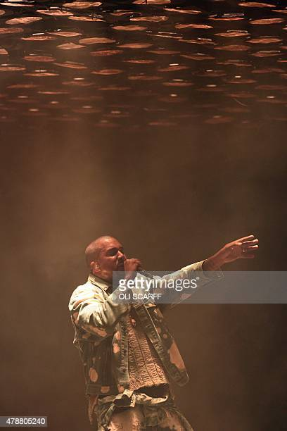 American singer Kanye West performs on the Pyramid Stage at the Glastonbury Festival of Music and Performing Arts on Worthy Farm near the village of...
