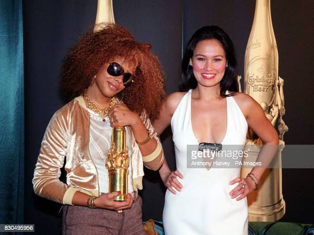 American singer Kelis and American actress Tia Carrere at a press conference after the MTV Europe Music Awards ceremony held at the Globe Arena in...