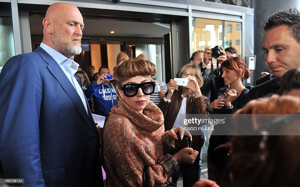 American singer Lady Gaga (c) is greeted by fans as she leaves her hotel on August 25, 2012 in Tallin, where she is to give a concert as part of her European tour.