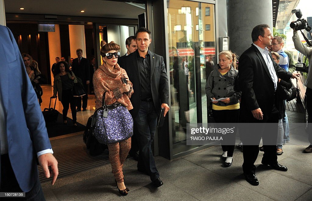 American singer Lady Gaga (L) is greeted by fans as she leaves her hotel on August 25, 2012 in Tallin, where she is to give a concert as part of her European tour.