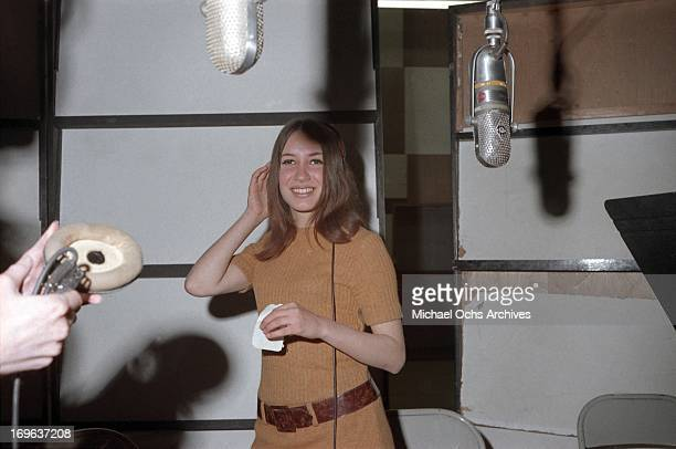 American singer Lani Hall with the Brazilian group Sergio Mendes and Brasil '66 poses for a portrait while recording at United Western Recorders...