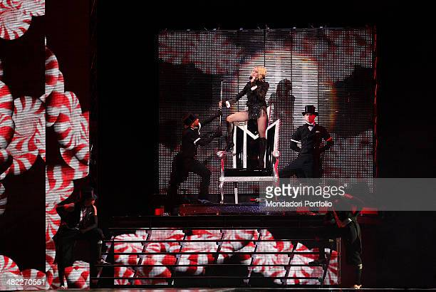 American singer Madonna performs a song in front of the audience in the Palais Nikaia in Nice during the second European stage of her Sticky and...