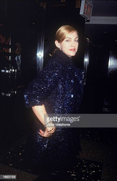 American singer Madonna wears a navy knit coat at the Gotham Awards New York City September 9 1995