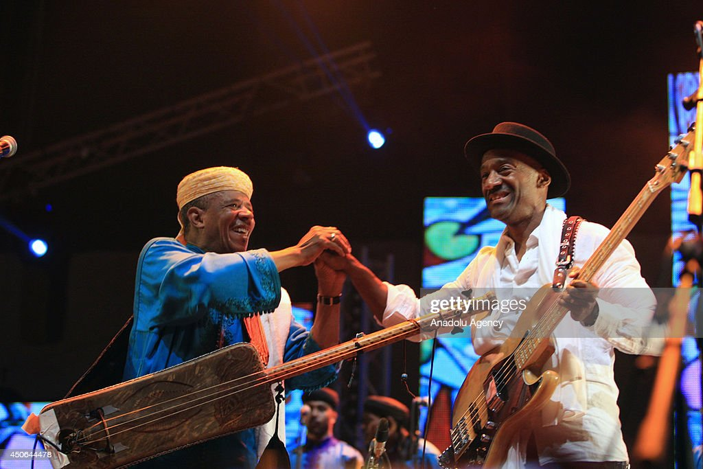 American singer Marcus Miller (R) and Moroccan singer Mustapha Baqbou perform during the 17th edition of the Gnaoua World Music Festival in Essaouira, Morocco on June 15, 2014. The 17th edition of the Gnaoua World Music Festival runs from June 12 to 15 attendance with many music groups.