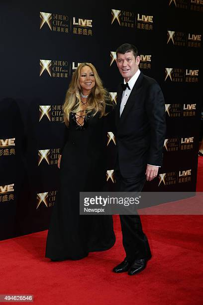 American singer Mariah Carey and Australian businessman James Packer arrive on the red carpet for the opening of Studio City casino in Macau China