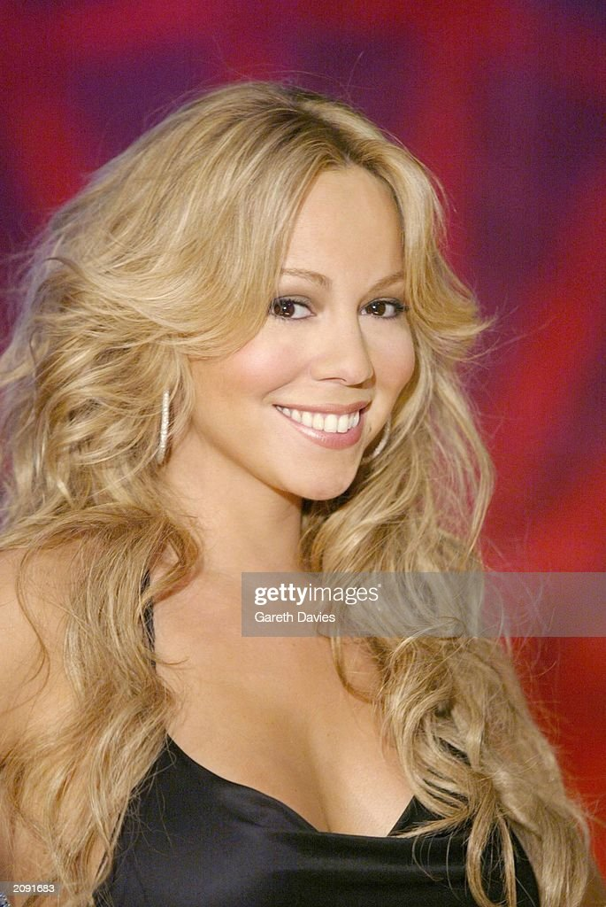 American singer <a gi-track='captionPersonalityLinkClicked' href=/galleries/search?phrase=Mariah+Carey&family=editorial&specificpeople=171647 ng-click='$event.stopPropagation()'>Mariah Carey</a> performs Live at MTV London on January 30, 2003