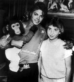 American singer Michael Jackson poses with 14yearold fan Donna Ashlock and his pet chimpanzee Bubbles at the Neverland Ranch in Santa Barbara County...