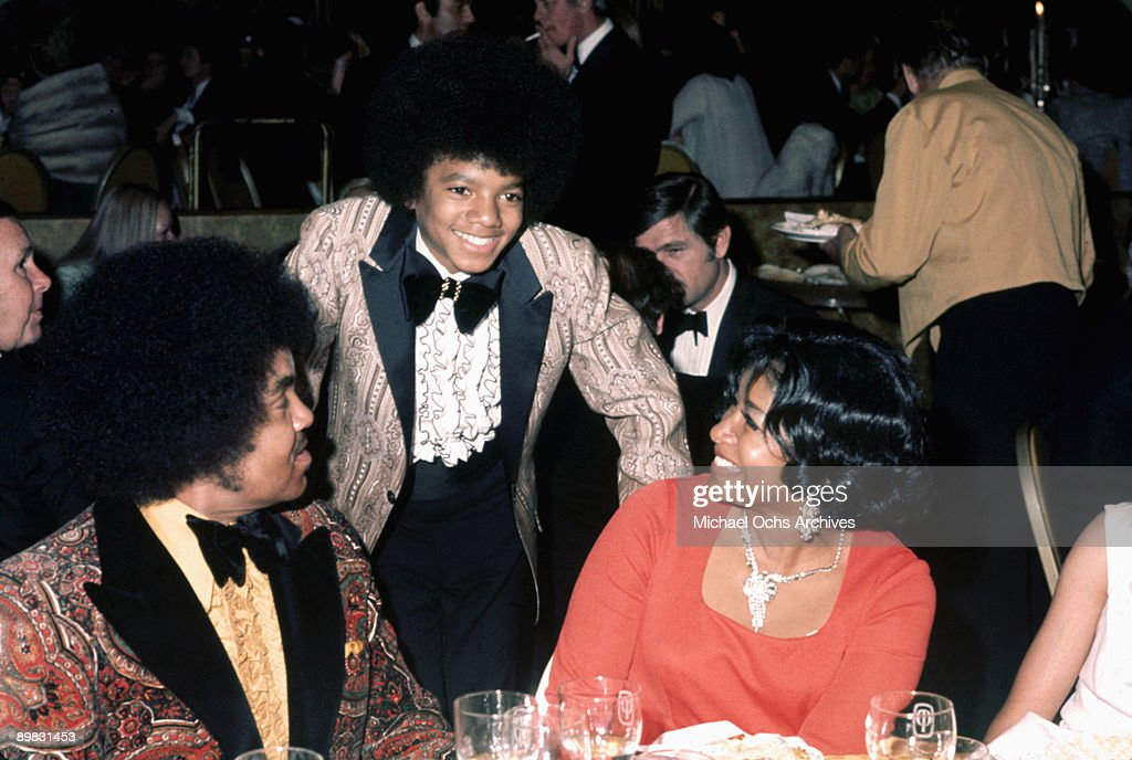 American singer <a gi-track='captionPersonalityLinkClicked' href=/galleries/search?phrase=Michael+Jackson&family=editorial&specificpeople=70011 ng-click='$event.stopPropagation()'>Michael Jackson</a> (1958 - 2009) with his parents, Katherine and Joseph, at the Golden Globes, held at the Century Plaza Hotel, Los Angeles, 28th January 1973.