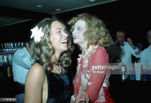 American singer Michele Phillips poses with South African singer and actress Genevieve Waite at a party at Le Club New York New York July 1974 At the...