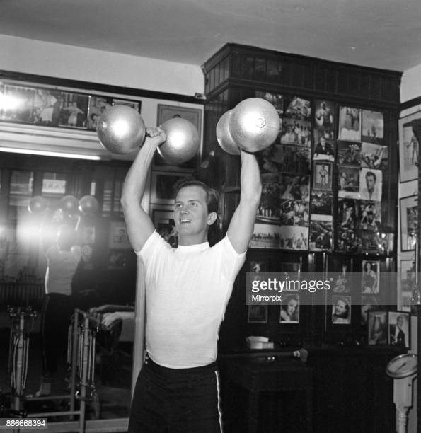 American singer Pat Boone exercises for his part in his next film 'The Main Attraction' where he plays a circus artist He will have some trapeze work...