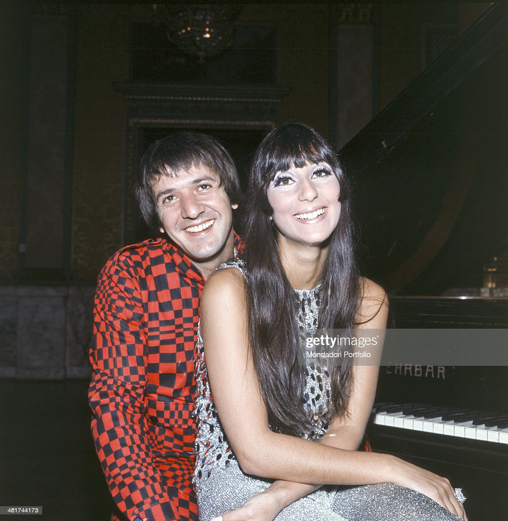 American singer Salvatore Philip Bono known as Sonny poses smiling with the singer Cherilyn Sarkisian LaPierre known as Cher Sonny wears a flashy...