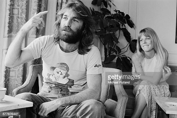 American singer songwriter and drummer with the Beach Boys Dennis Wilson New York 6th September 1977 In the background is Wilson's wife actress Karen...