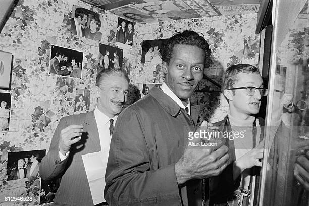 American singer, songwriter and guitarist Chuck Berry in his dressing room at the Olympia music hall.
