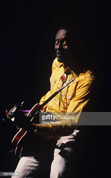 American singer and guitarist Chuck Berry performs on stage in 1991