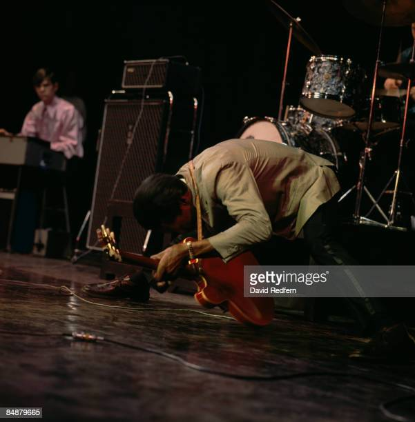 Photo of Chuck BERRY Chuck Berry performing on stage doing the splits