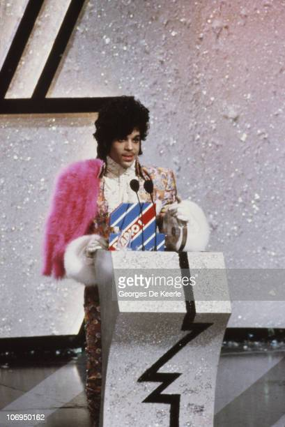American singer songwriter and musician Prince collects the award for Best International Artist at the British Record Industry Awards aka the BRIT...