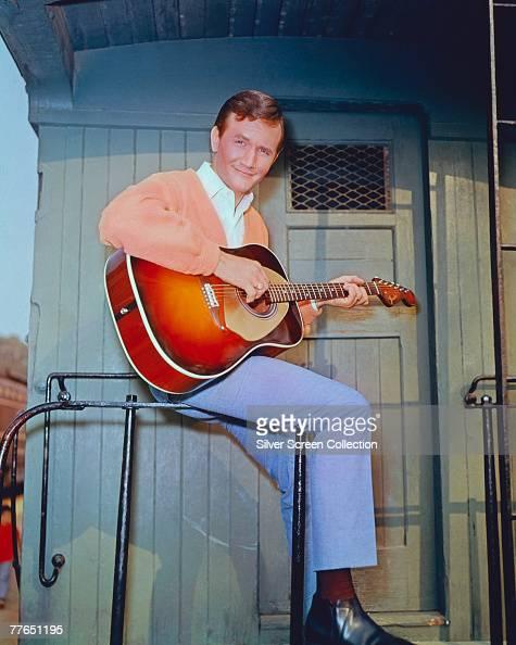 American singer songwriter and musician Roger Miller circa 1965